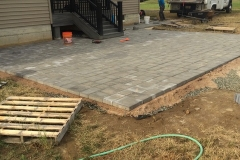 Paver patio with fire pit (during)