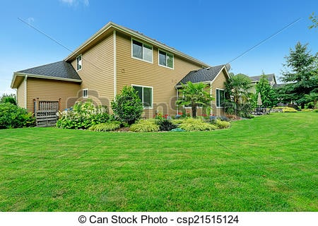 Backyard with large lawn & flower beds